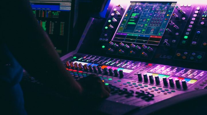 Hands mixing on an Allen & Heath DLive digital audio console